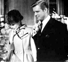 Photo of George Peppard and Audrey Hepburn